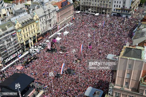 People gather for a heroes' welcome in tribute to Croatian national football team after reaching the final at the Russia 2018 World Cup at the Bana...