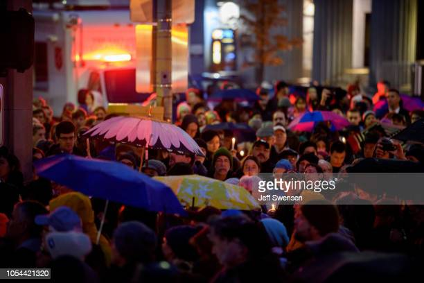 People gather for a interfaith candlelight vigil a few blocks away from the site of a mass shooting at the Tree of Life Synagogue on October 27 2018...