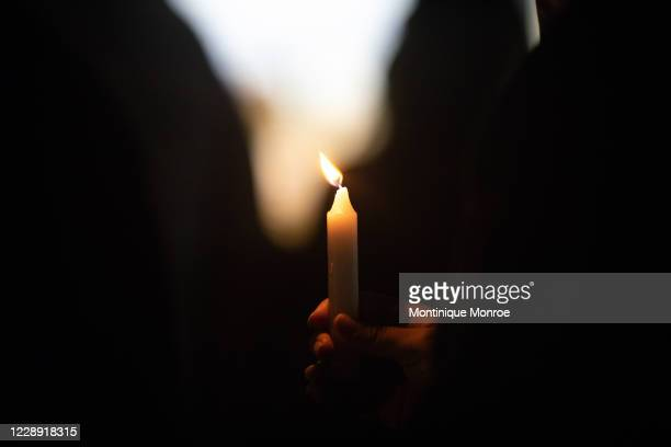 People gather for a march, rally and candle light vigil in honor Jonathan Price on October 5, 2020 in Wolfe City, Texas. Wolfe City police officer...