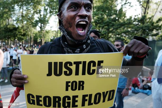 People gather for a memorial rally and march in Brooklyn in honor of George Floyd on the one year anniversary of his death on May 25, 2021 in New...