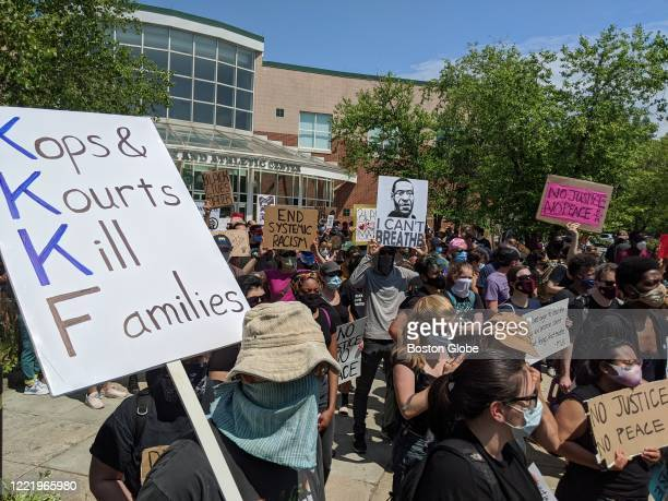 People gather for a protest and March in honor of Rayshard Brooks from Reggie Lewis Center to The State House in Boston on June 22 2020