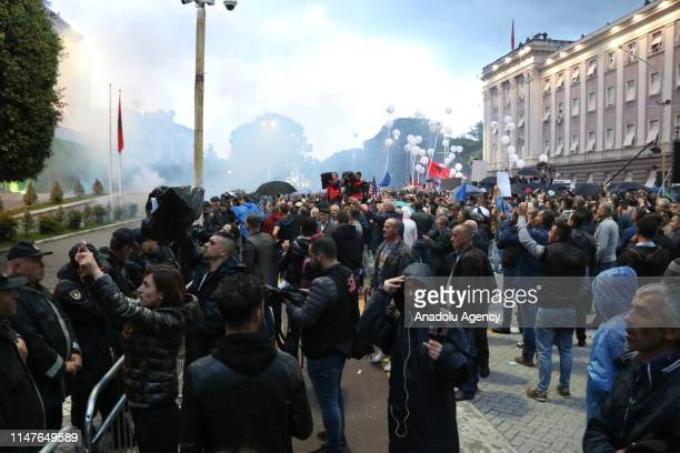 People gather for a protest organized by Democratic Party of Albania and Socialist Movement for Integration against the government demanding the...