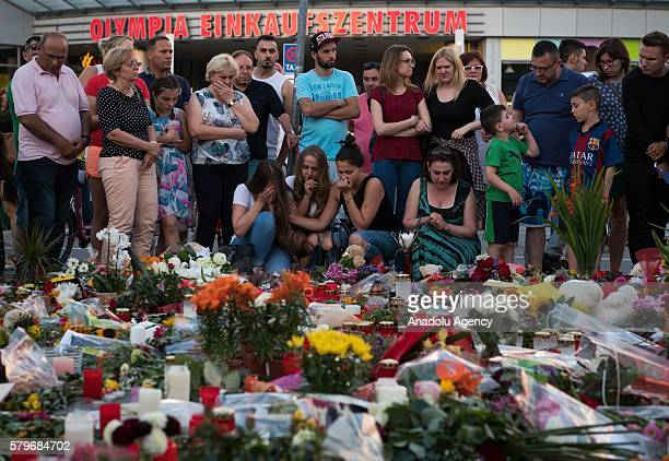 People gather for a silent memorial in front of the Olympia shopping center in Munich Germany 24 July 2016 According to authorities at least 10...