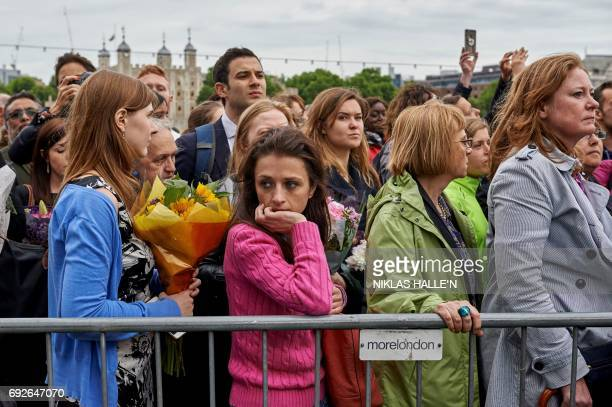 TOPSHOT People gather for a vigil at Potters Fields Park in London on June 5 2017 to commemorate the victims of the terror attack on London Bridge...