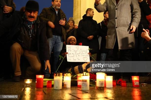 People gather for a vigil at the Brandenburg Gate to commemorate the victims of the Hanau shootings on February 20 2020 in Berlin Germany A local man...