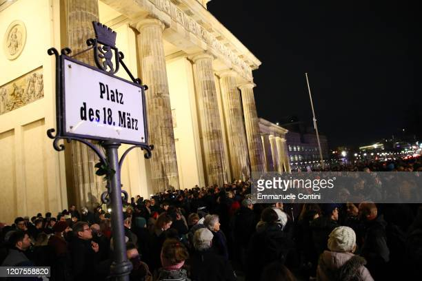 People gather for a vigil at the Brandenburg Gate to commemorate the victims of the Hanau shootings on February 20, 2020 in Berlin, Germany. A local...