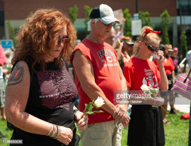 People gather for a vigil for the victims of the mass shooting that occurred over night, at the Levitt Pavilion on August 4, 2019 in Dayton, Ohio. In...