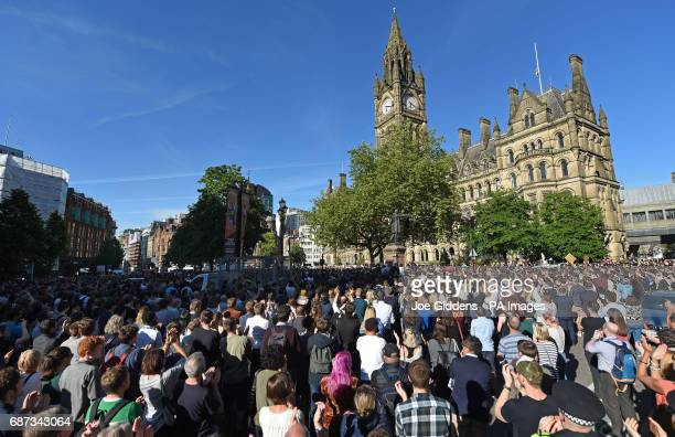 People gather for a vigil in Albert Square outside Manchester Town Hall in Manchester after a 23yearold man was arrested in connection with the...