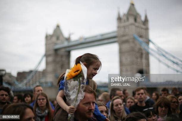 TOPSHOT People gather for a vigil in Potters Fields Park in London on June 5 2017 to commemorate the victims of the terror attack on London Bridge...