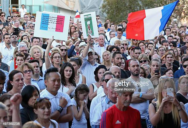 People gather for a vigil to honour victims of the Paris terror attacks at Federation Square on November 16 2015 in Melbourne Australia 129 people...