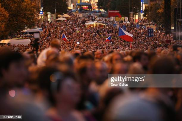 People gather for an evening concert on Wenceslas Square as part of events to commemorate the 50th anniversary of the 1968 Warsaw Pact invasion of...