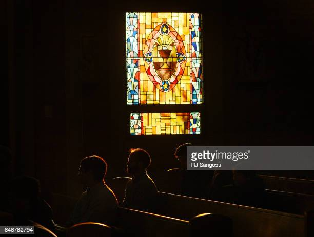 People gather for Ash Wednesday Mass at Christ the King Catholic Church in Denver March 01 2017 Ash Wednesday opens Lent a season of fasting and...
