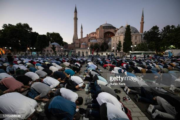 People gather for evening prayers outside Istanbul's famous Hagia Sophia on July 10 2020 in Istanbul Turkey Turkey's top administrative court ruled...