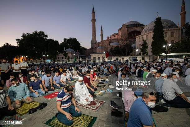 People gather for evening prayers outside Istanbul's famous Hagia Sophia on July 10, 2020 in Istanbul, Turkey. Turkey's top administrative court...