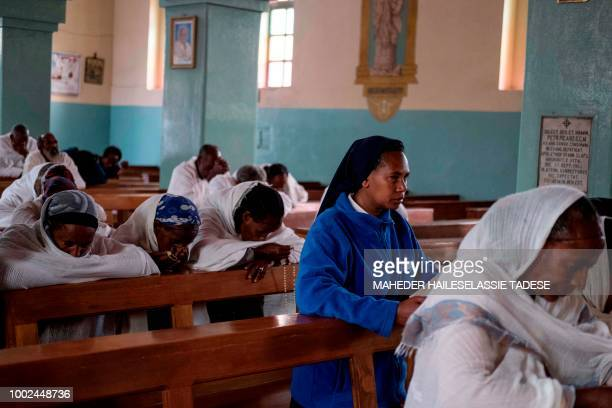 People gather for morning mass at Lideta Mariam Catholic Church in Alitena on July 13 2018 A breakneck peace process between the former foes over the...