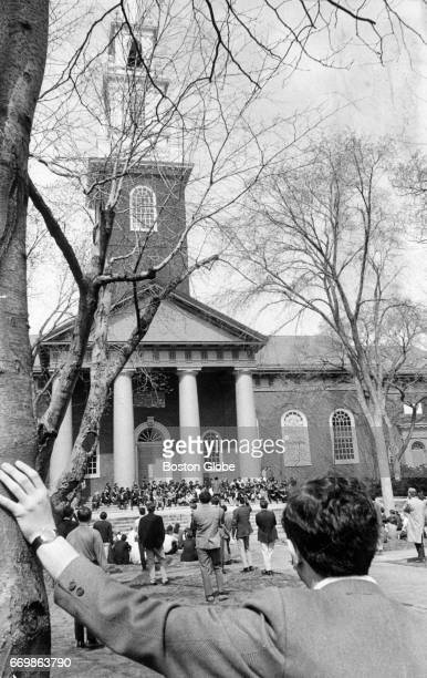 People gather for outdoor services for Martin Luther King in front of Memorial Church on the campus of Harvard University in Cambridge Mass on April...