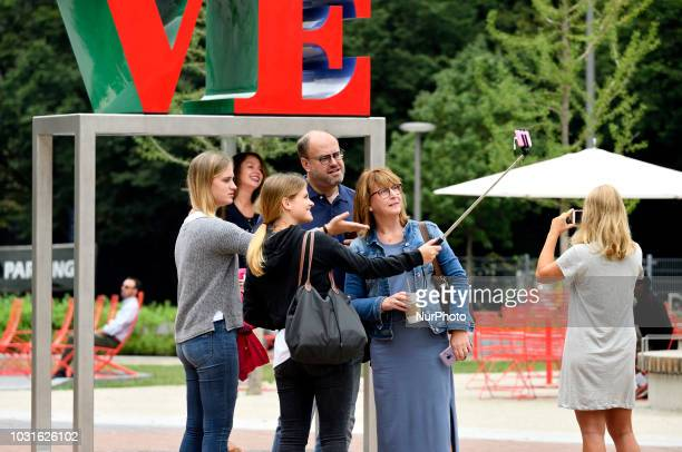 People gather for pictures at the iconic LOVE park statue located on JFK Plaza in Center City Philadelphia PA on September 11 2018