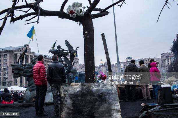 People gather for prayers and to listen to speakers in Independence Square on February 23 2014 in Kiev Ukraine After a chaotic and violent week...