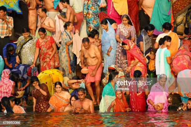 people gather for ritual cleansing ganges river in varanasi india - ceremony stock pictures, royalty-free photos & images
