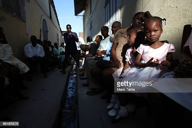 People gather for spiritual services in the courtyard of a church February 7, 2010 in Jacmel, Haiti. Most church services are being held outside the...