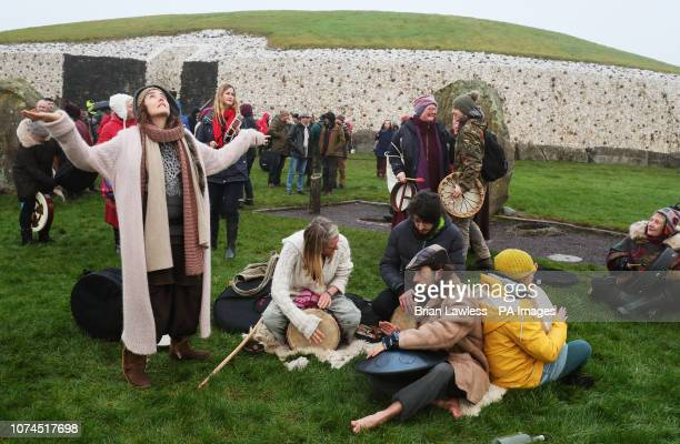 People gather for sunrise at Newgrange on the morning of the winter solstice which is marked by pagan celebrations