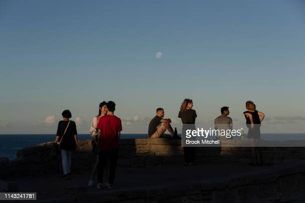 People gather for sunset at Mackenzies Point Bondi in the Wentworth Electorate on April 17 2019 in Sydney Australia Australians will head to the...