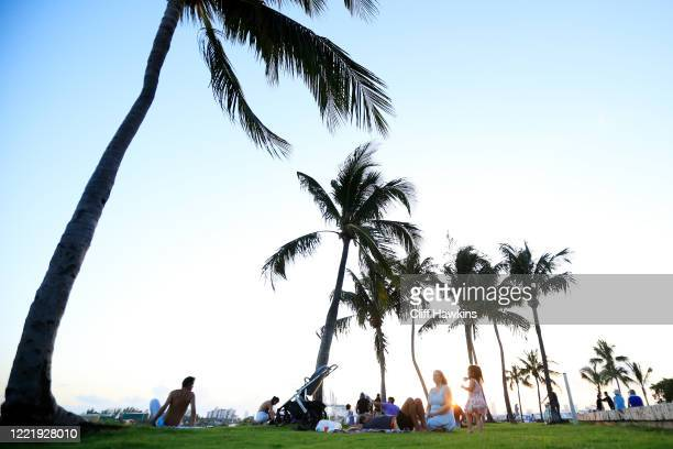 People gather for sunset in South Pointe Park on April 29 2020 in Miami Beach Florida The city of Miami Beach partially reopened parks and facilities...