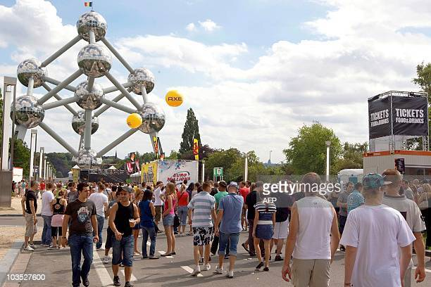 People gather for the 'Axe City Parade' electronic dance music festival on August 21 near the Atomium at the Heysel in Brussels AFP...