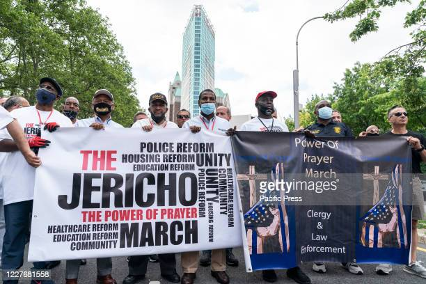 People gather for the Jericho The Power of Prayer rally and march against gun violence at Cadman Plaza. Pro-police clergy and law enforcement led...