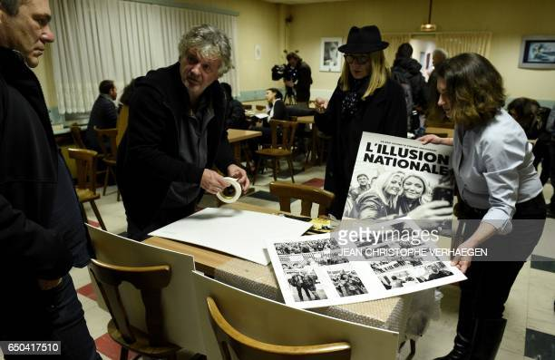People gather for the launch of a photographic novel entitled 'L'illusion nationale' in Hayange eastern France on March 08 2017 After two years of...