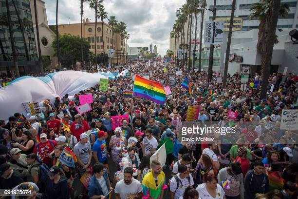 People gather for the start of #ResistMarch during the 47th annual LA Pride Festival on June 11 2017 in the Hollywood section of Los Angeles to march...