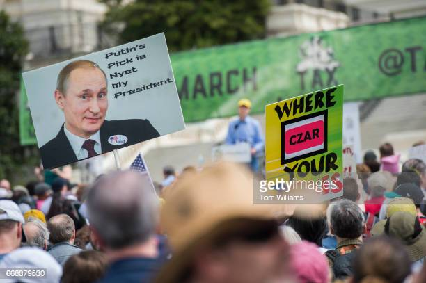 People gather for the Tax March rally on the west lawn of the Capitol to call on President Trump to release his tax returns April 15 2017 Sen Ron...