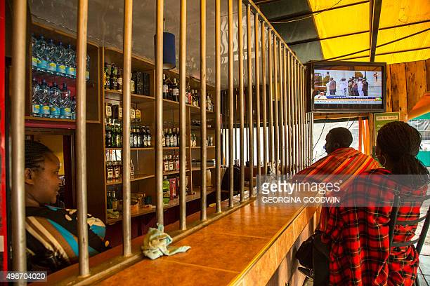People gather in a bar to watch the news as Pope Francis arrives at Jomo Kenyatta International Airport in Nairobi on November 25 2015 Pope Francis...