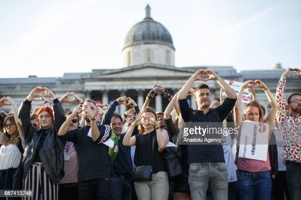 People gather in a memorial ceremony at Trafalgar Square in London England on May 23 2017 in memory of the victims of terror attack which killed 22...