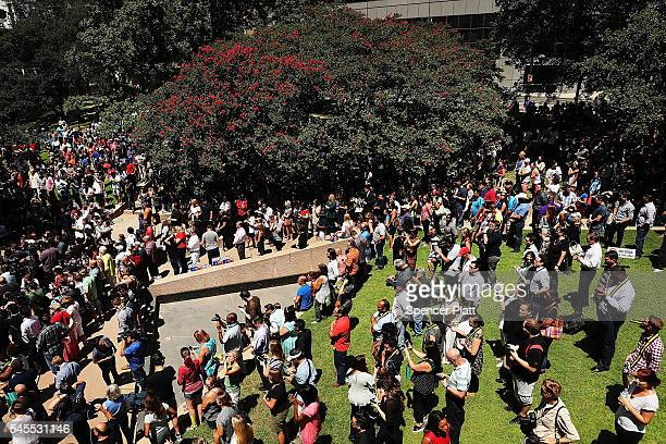 People gather in a prayer vigil following the shooting deaths of five police officers last night during a Black Live Matter march on July 8 2016 in...
