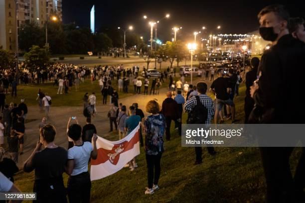 People gather in a protest against Belarus President Alexander Lukashenko's claim of a landslide victory on August 9, 2020 in Minsk, Belarus....