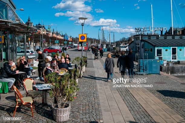 People gather in a restaurant on April 4 2020 in Stockholm during the the new coronavirus COVID19 pamdemic