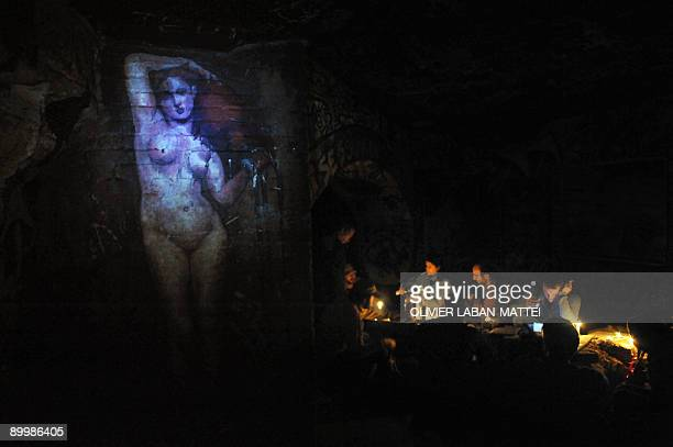 CARO People gather in a room of the catacombs of Paris on August 2 2008 Parts of the French capital are riddled with around 250 kilometres of...