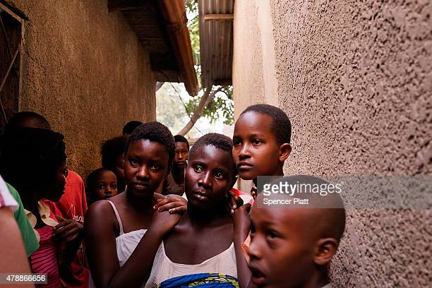 People gather in a street where a man who was killed by police the previous evening on June 28, 2015 in Bujumbura, Burundi. Patrick Ndikumana was...