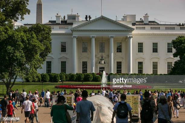 People gather in along The White House mall on June 4 2017 in Washington DC The nation's capital the sixth largest metropolitan area in the country...