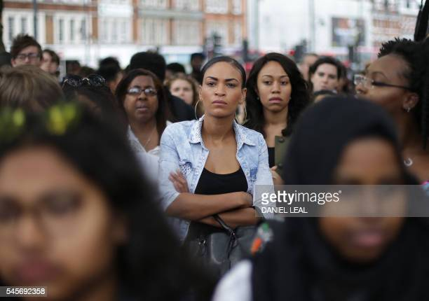 People gather in Brixton south London to protest against police brutality in the US on July 9 after two recent incidents where black men have been...