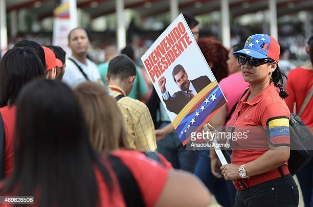 People gather in Caracas to the celebrations for the fifth anniversary of the Bolivarian Militia in Caracas while waits for the arrive of President...