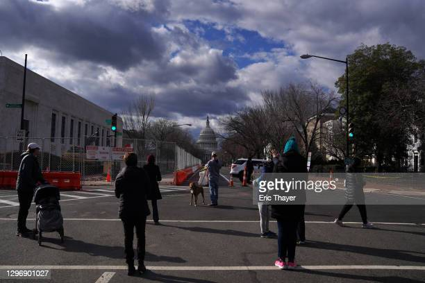 People gather in front of a blocked off street near the U.S. Capitol building on January 17, 2021 in Washington, DC. After last week's riots at the...