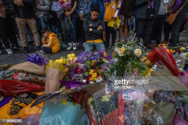 People gather in front of a makeshift memorial for former NBA and Los Angeles Lakers player Kobe Bryant and his daughter Gianna Bryant who were...