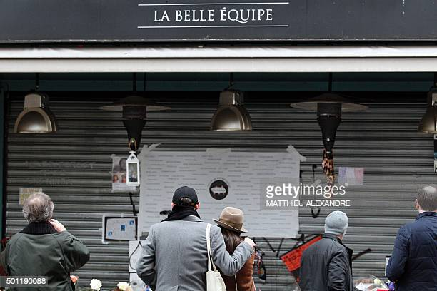 """People gather in front of a makeshift memorial in front of the cafe """"La Belle Equipe"""" on rue de Charonne in Paris' 11th arrondissement in Paris on..."""