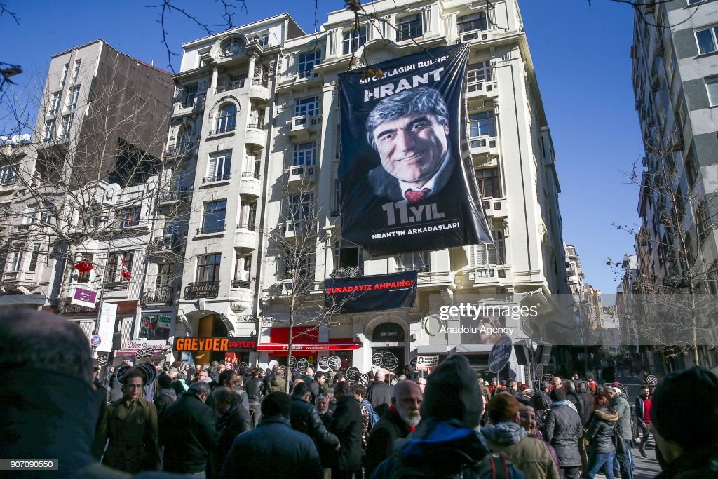 People gather in front of Agos newspaper's office building where Hrant Dink was murdered for commemoration ceremony on his 11th death anniversary in Istanbul, Turkey on January 19, 2018. Hrant Dink, former editor-in-chief of the bilingual Turkish-Armenian newspaper Agos, was assassinated in Istanbul in 2007.
