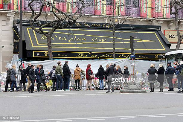 People gather in front of 'Le Bataclan' concert hall where 89 people where killed during the paris attacks a month ago on December 13 2015 in Paris...