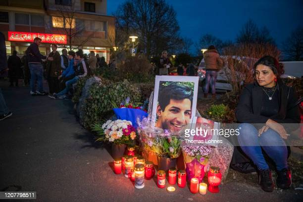 People gather in front of the Arena Bar Cafe to commemorate the victims of the recent shooting on February 21 2020 in Hanau Germany On the night of...