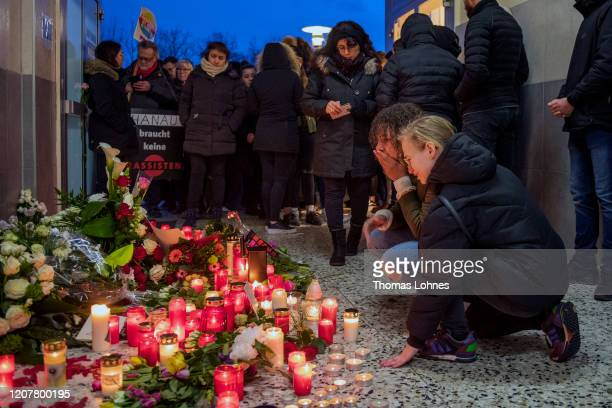 People gather in front of the Arena Bar Cafe to commemorate the victims of the recent shooting on February 21 2020 in Hanau Germany A total of 11...