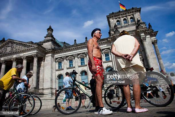 People gather in front of the Bundestag and the Reichstag building during the election of a new German president by the Federal Assembly at Reichstag...